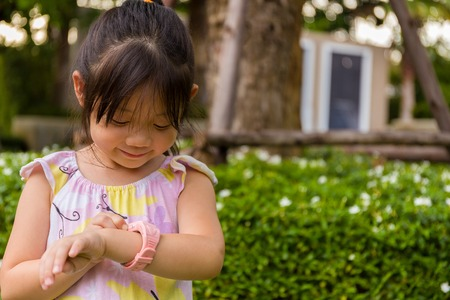 Little Girl Using Smartwatch or Smart Watch