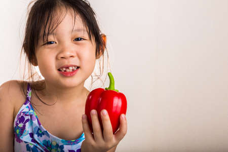 bell pepper: Little Girl with Bell Pepper