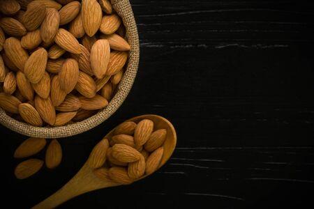 almond: Almond on Wooden Background Stock Photo