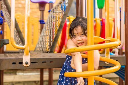 female children: Happy Child Playing on Playground Stock Photo