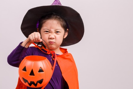 costumes: Child in Halloween Costume on White Stock Photo