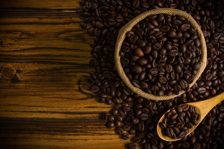 seeds coffee: Coffee Beans on Wooden Background