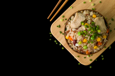 bowl with rice: Chinese Fried Rice on Black Background Stock Photo