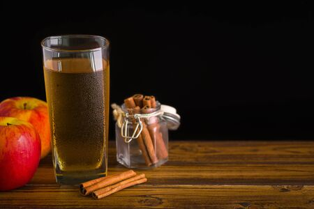cider: Apple Cider with Cinnamon on Black Background