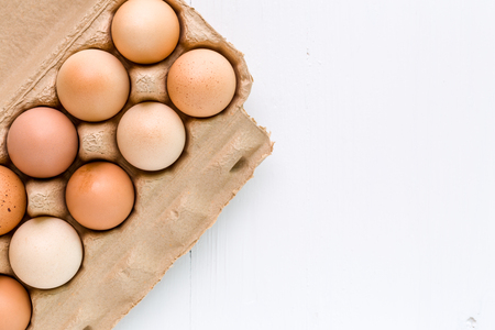 egg white: Fresh Eggs on White Background Stock Photo