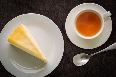 cakes: Cake and Tea on Black Background Stock Photo