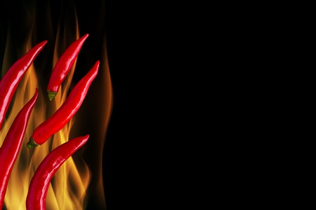 red chili pepper: Chili on Flame with Black Background
