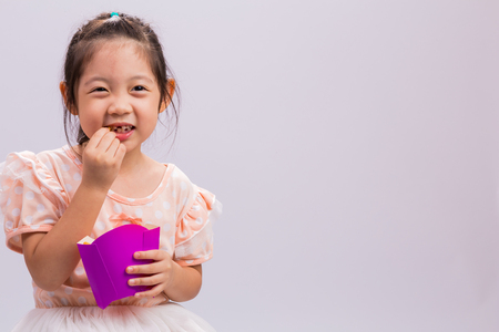 snack food: Child Eating French Fries Stock Photo