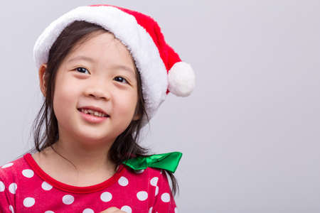 christmas costume: Little Girl in Christmas Costume with Santa Claus Hat
