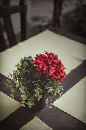 on the table: Vintage Flower on Table Stock Photo
