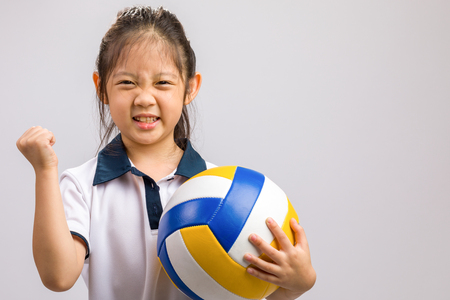 Child Holding Volleyball, Isolated on White