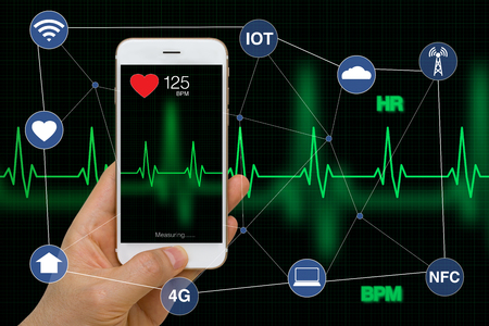 Smart Phone Measuring Heart Rate Application Concept with Heart Beat Cardiogram While Exercising