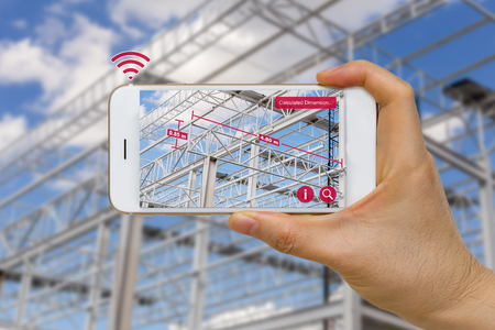 industry: Application of Augmented Reality in Construction Industry Concept Measuring Dimension of Steel Structure Stock Photo