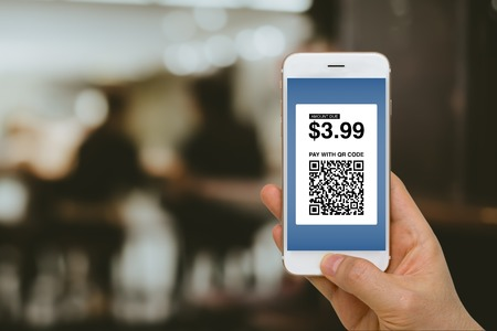 Paying for Goods and Services by Smartphone Using E-Wallet App and E-Money, Fintech Concept