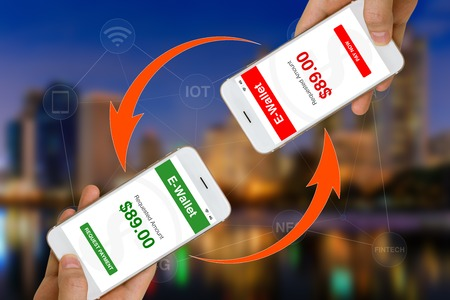 Fintech or Financial Technology Concept Illustrated by Using Smartphone and E-Wallet App to Make Payment or Transfer Money Stock Photo
