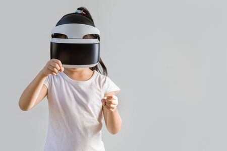 virtual world: Child with Virtual Reality, VR, Headset Studio Shot Isolated on White Background. Kid Exploring Digital Virtual World with VR Goggles.