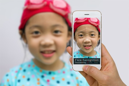 Biometric Verification, Face Recognition Technology Concept, Using App on Smartphone 写真素材