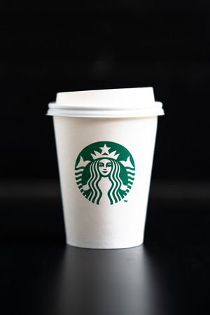 Bangkok, Thailand – August 26, 2018: Starbucks Coffee Cup on Black Background. Starbucks is one of the largest coffee chain stores in the world.
