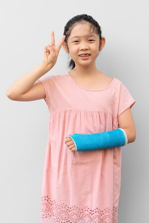 Asian Child with Broken Arm in Cast with Smiling Face Expression