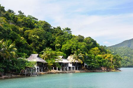 Tropical resort with bulgalows at the coastline of the Koh Chang island, Thailand.