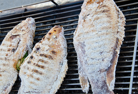 Grilled fish with salt photo
