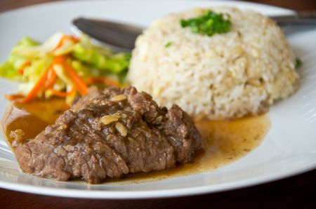 baby rice: Roast beef with rice for my lunch Stock Photo