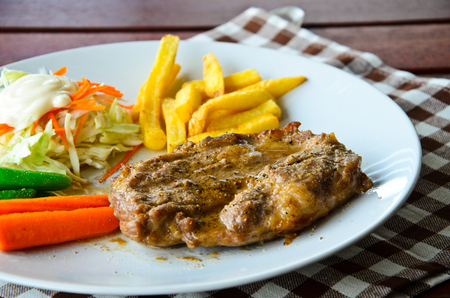 pork steak is very delicious for lunch photo