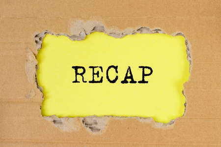 RECAP word inscription on torn craft paper on yellow table, summary concept Imagens