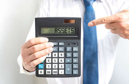 word Assets on calculator. Financial accounting. Money concept.