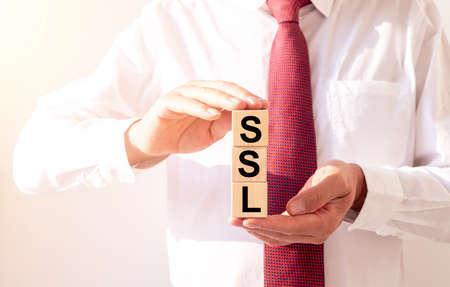 SSL, security certificate for web site written on wooden cube blocks.