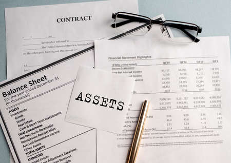 word Assets on paper on office table. Financial accounting. Money concept.