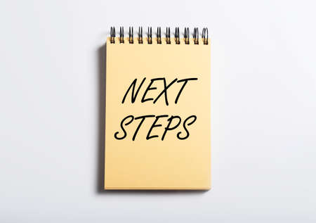 Next steps inscription. Future planning for goals achievement concept.
