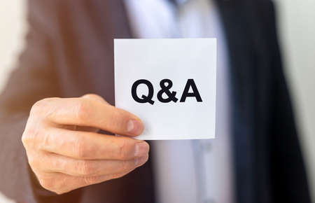 Q&A inscription on paper, questions and answers concept.