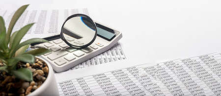 Business financial analysis and research concept. Calculating income and profit. Table full of documents with digits and calculations. Banner with copy space
