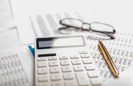 Business financial concept. Accountant workplace with calculator and documents