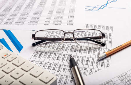 Business financial concept. Accountant workplace with documents close up
