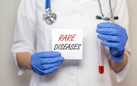 Rare diseases inscription words. Medical concept of unusual disorders. Foto de archivo