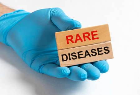 Rare diseases inscription words. Medical concept of unusual disorders. Stock Photo