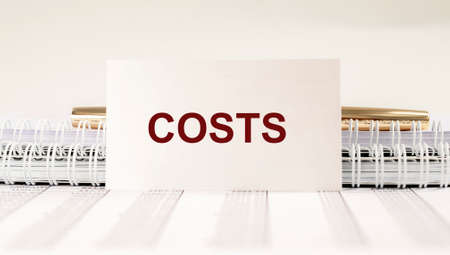 Costs word, inscription. Concept of business and money.