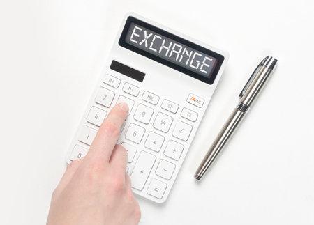 Word Exchange on calculator. Financial concept.