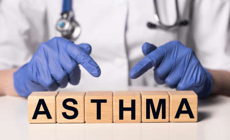 Asthma word, inscription on cubes in doctor hands