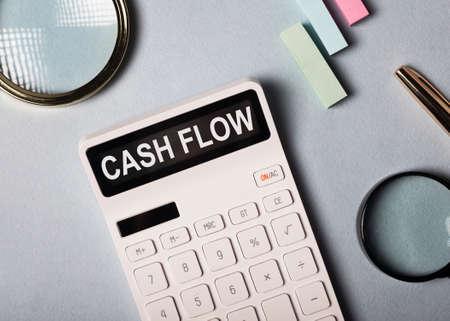 Cash flow word on calculator, cashflow inscription Stock Photo