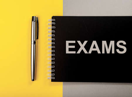 Word exams on trendy colored background. Education. Stock Photo