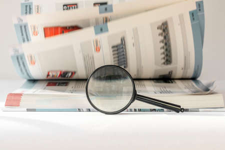 Technical engineer book with turning pages and magnifying glass. Research concept. Stock Photo