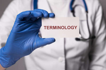 Medical terminology word in doctor hands. Medicine terms concept.