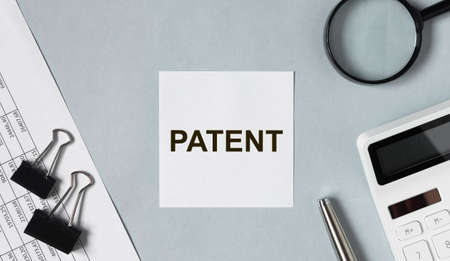 Word Patent on paper note. Intellectual law. Stock Photo