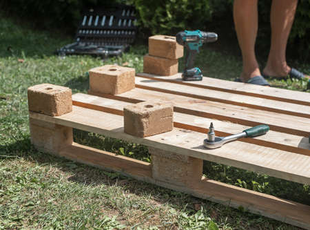 Wooden pallet for handmade furniture, constructing and repairing in nature.