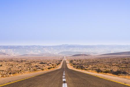 Beautiful road in the desert, going beyond the horizon  Israel photo
