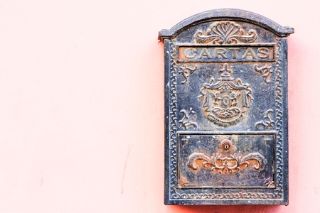 beautiful old mailbox hanging on the wall photo