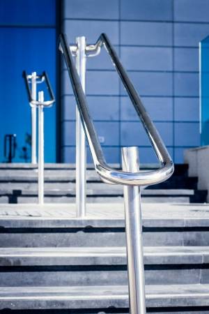 handrails: Stainless steel handrails are installed on the walls and steps  Stock Photo